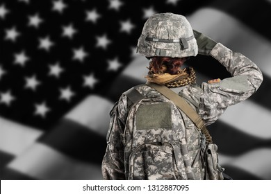 Female in US Army soldier (ISAF) uniform saluting. Shot in studio. Flag of USA on background (black and white)