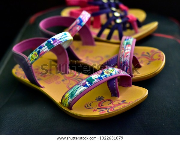 Female use stylish sandals, slippers isolated object stock photograph