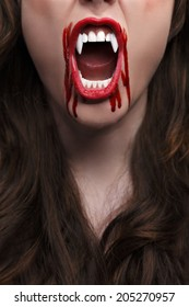 Female vampire with bloody teeth