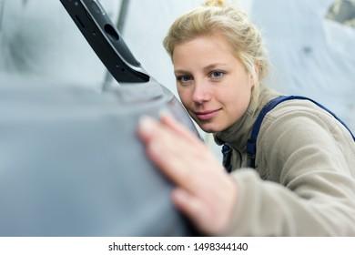 female vehicle body part assembler