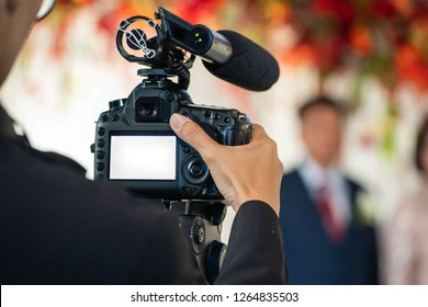 Female Videographer in backside are shooing and recording video in Wedding Event.