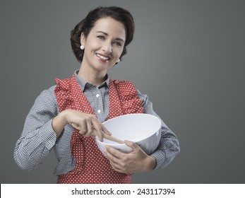 Female vintage cook mixing ingredients in a bowl and smiling