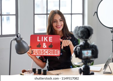 Female vlogger asking online audience to like and subscribe to her channel, daily videos