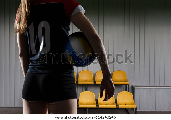 Female Volleyball Player Seen Behind Holding Stock Photo