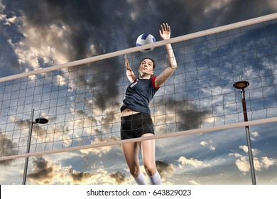 Female volleyball players jumping close-up