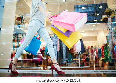 Female walking in shopping mall