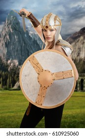 female warrior attacking with shield and sword