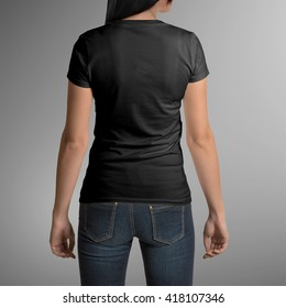 Female wearing black t-shirt, back view, isolated on gray background, with clipping path to change background