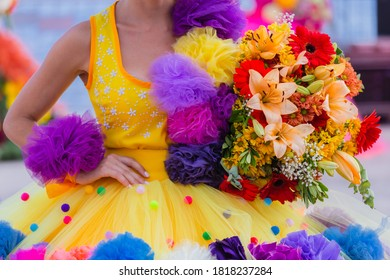 """Female wearing decorativo and traditional clothe of Madeira Flower Festival"""" in Madeira island, Portugal"""