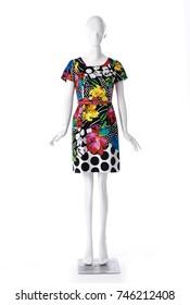 female wearing floral sundress clothing on full-length mannequin isolated-white background