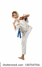 Female wearing martial arts uniform making karate move isolated on white background