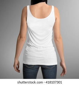 Female wearing white tank top shirt, back view, isolated on gray background, with clipping path to change background