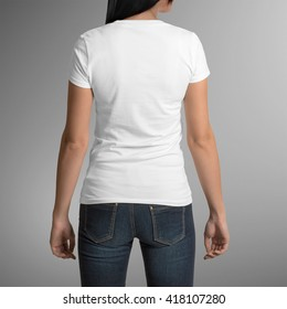 Female wearing white t-shirt, back view, isolated on gray background, with clipping path to change background
