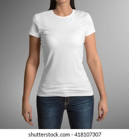 Female wearing white t-shirt isolated on gray background, with clipping path to change background