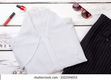 Female white blouse and black skirt. Set of business style apparel and accessories for women. Lookbook of female formal outfit.