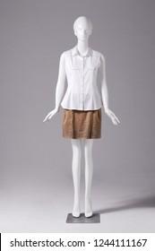 Female white clothing in skirt on full mannequin isolated-gray background