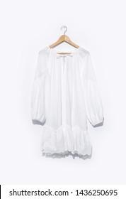 female white dress hanging on hanger