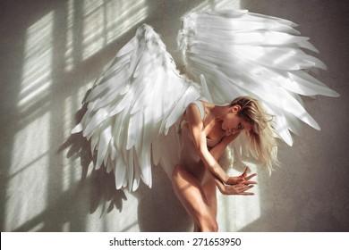 female with wings posing in studio