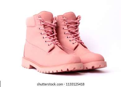 female winter boots pink color isolated on white. women's shoes.
