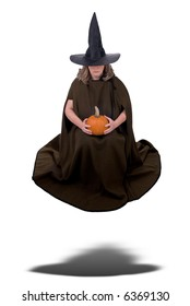 Female witch holding a pumpkin and floating isolated over white