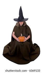 Female witch holding a pumpkin isolated over white