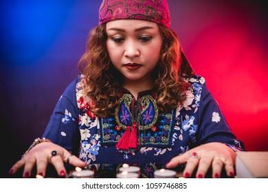 Female woman seer teller fortune psychic fortuneteller predicting fate for sign