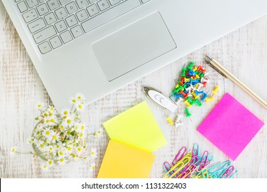 Female woman work from home desk with laptop computer, office supplies and flowers