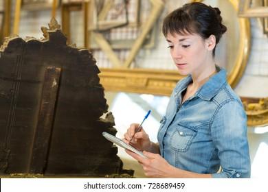 female wooden antique restoration worker