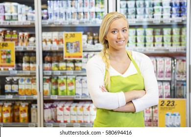 Female Worker With Arms Crossed In Grocery Store