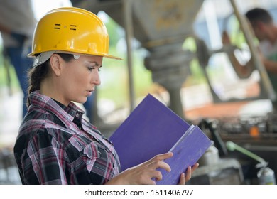 female worker looking up in warehouse