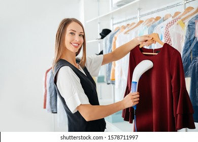 Female worker at modern dry-cleaner's