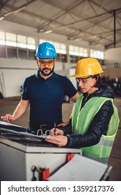 Female workplace safety inspector preforming inspection at industrial factory