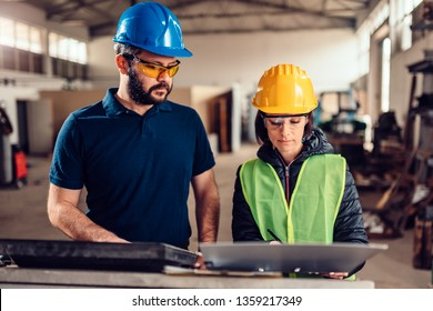 Female workplace safety inspector writing a report at industrial factory