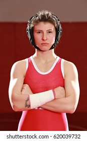 Female wrestler in a singlet and headgear. Looking at camera