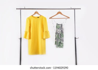 female yellow sundress with shoes on hanger-wooden background