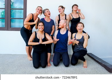 Female yoga students and their yoga teacher.