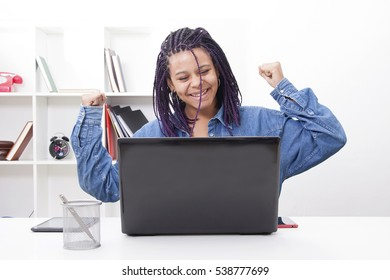 female young celebrating the success with the computer laptop