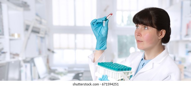 Female young doctor-intern, tech or a scientist with blood test tubes medical or research facility, panoramic image