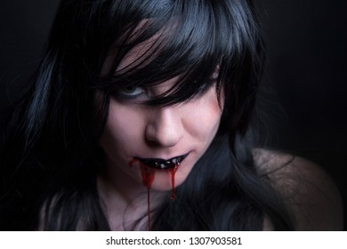 Female zombie with blood in her mouth, Halloween