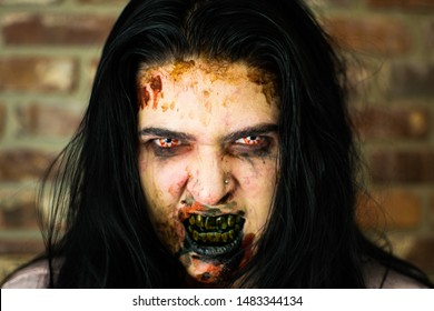 Female Zombie Headshot with Black Teeth and Zombie Eyes