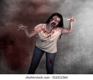 Female zombie over grunge background. Halloween concept