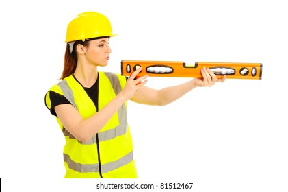 A females dressed in a high visibility vest looking along a spirit level on isloated white background