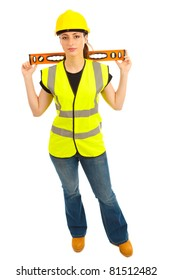 A females dressed in a high visibility vest holding a spirit level across her back on isloated white background