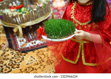Female's hand in green Semeni . Navruz Nowruz holiday, the spring New Year holiday.