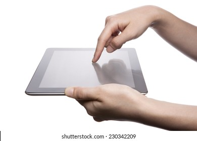 A female(woman, girl) hand support tablet pc device(iPad, tab) and finger touch the screen isolated white at the studio.