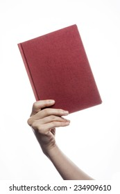 A female(woman) hand hold a empty(blank) book(diary, note) cover isolated white at the studio.