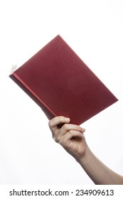 A female(woman) hand hold a empty(blank) book(diary, note) cover spread isolated white at the studio.