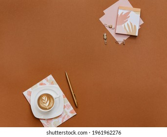 Femenine Creative flat lay photo of workspace desk with coffee cup and notebook, top view, copy space