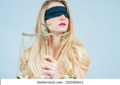 Femida, Goddess of Justice with scales wearing blindfold