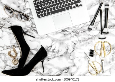 Feminine accessories, notebook, shoes, office supplies on bright marble table background. Fashion flat lay for blogger social media
